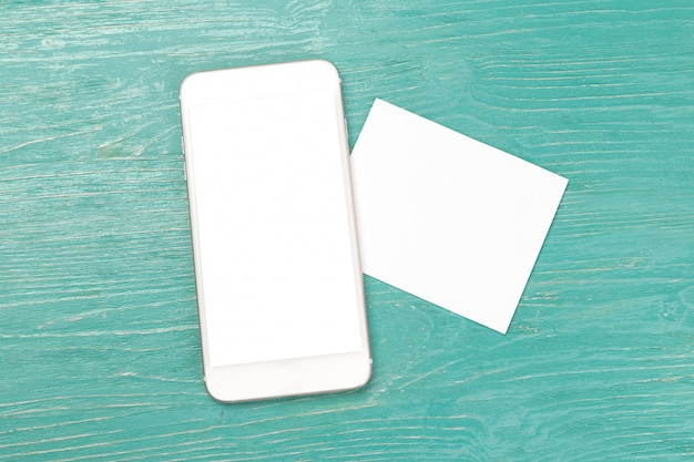 Blank screen smartphone on wooden table. Premium Photo