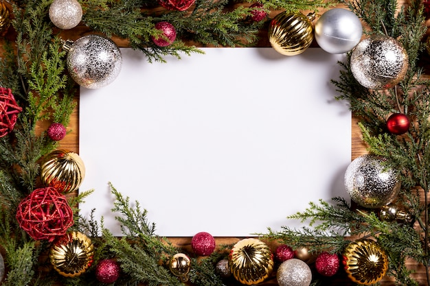 Blank sheet and christmas decorations frame Free Photo