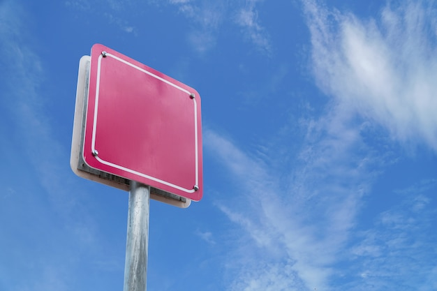 Blank sign pink wite blue sky. Premium Photo
