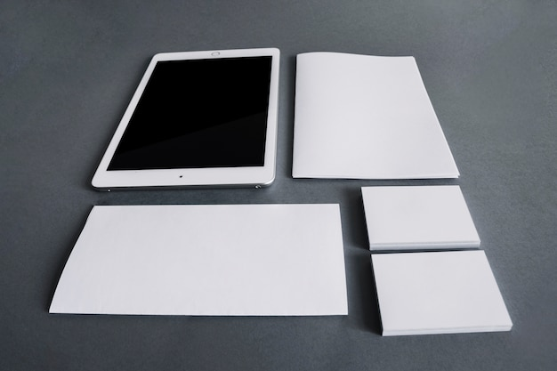 Blank stationery concept with tablet Free Photo