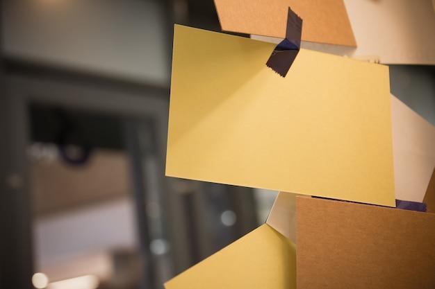 Blank sticky notes hanging Premium Photo