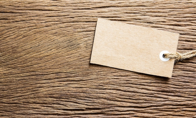 Blank tag tied on wooden background Premium Photo