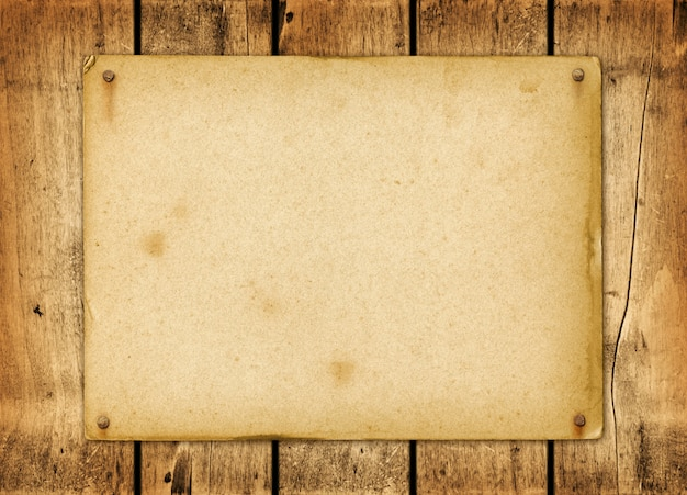 Blank vintage paper nailed on a wood board Premium Photo