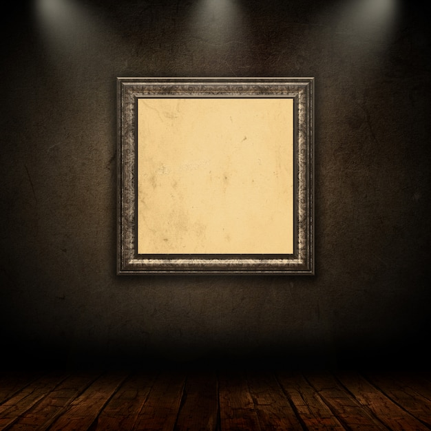 Blank vintage picture frame in grunge room with spotlights Free Photo