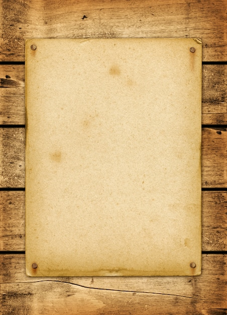 Blank vintage poster nailed on a wood board Premium Photo
