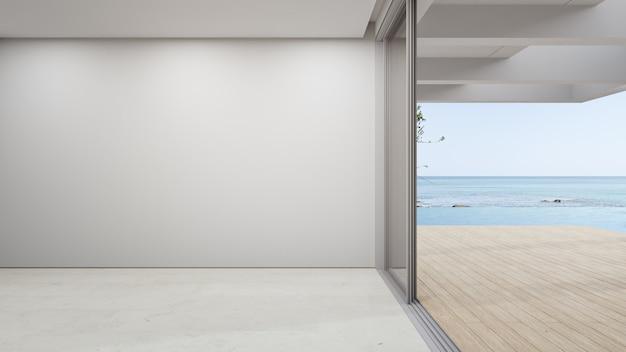 큰 거실의 빈 베이지 색 대리석 바닥에 빈 벽. 프리미엄 사진