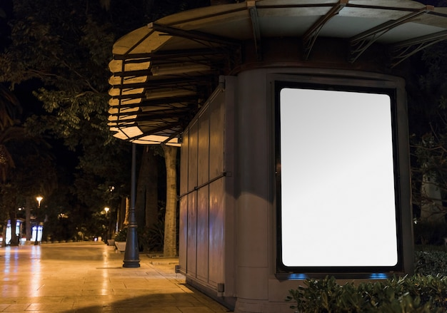 Blank white advertisement panel in city Free Photo