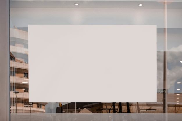 Blank white billboard on the glass Free Photo