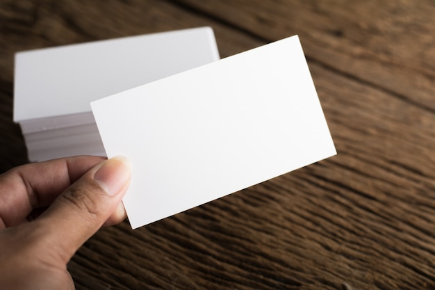 Blank white business card presentation of corporate identity on wood background Free Photo