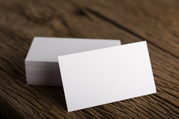 blank white business card presentation of corporate identity on wood