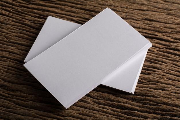 Blank white business card presentation of corporate identity on wood blank white business card presentation of corporate identity on wood background free photo reheart Choice Image