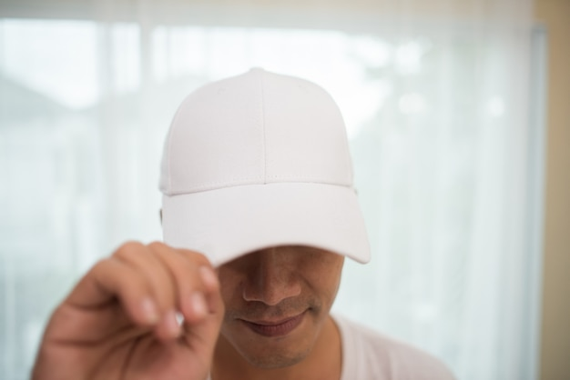 Blank white cap on the head ready for branding. Free Photo