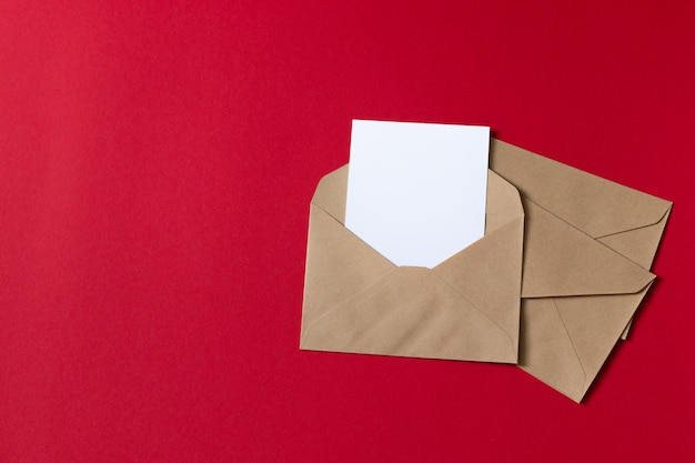 Blank white card with kraft brown paper envelope template mock up Premium Photo