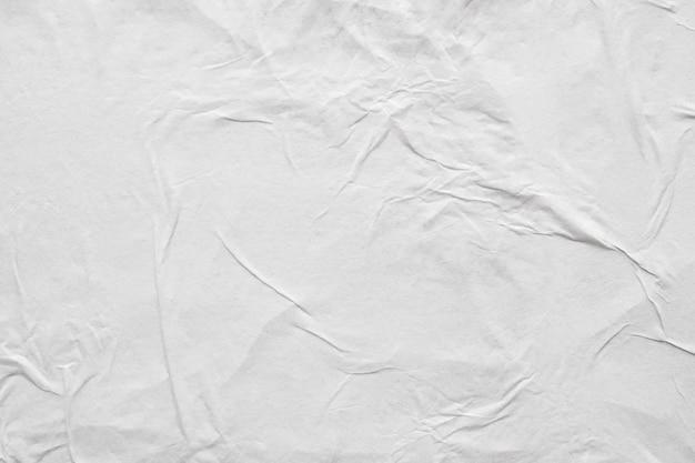 空白の白いしわくちゃにしわの紙のポスターのテクスチャ Premium写真