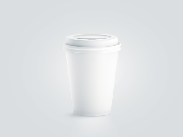 Blank white disposable paper cup with plastic lid mock up Premium Photo