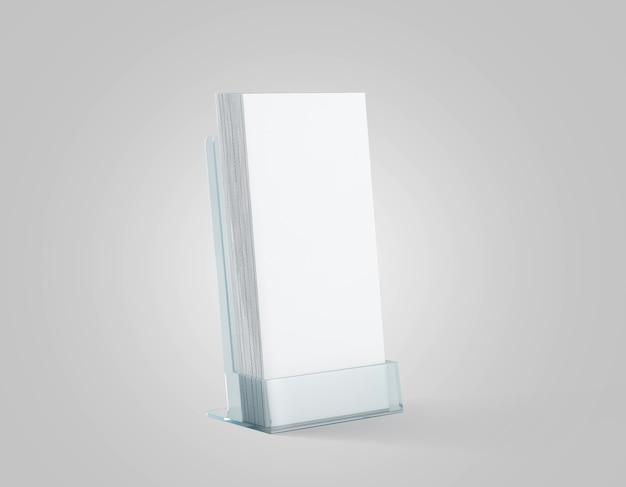 유리 플라스틱 홀더에 빈 흰색 전단지 스택 프리미엄 사진
