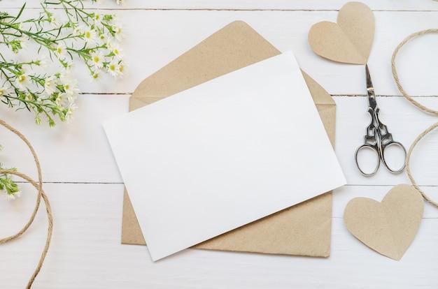 blank white greeting card with brown envelope  premium photo