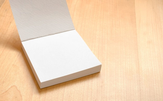 blank white notepad on wooden table template mock up for adding your