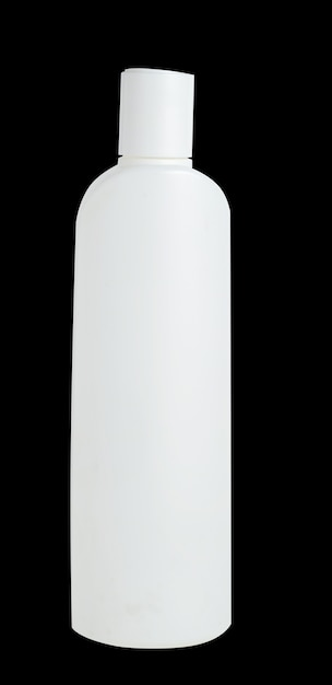 Blank white plastic bottle isolated on black background. packaging for cosmetic, shampoo. Premium Photo