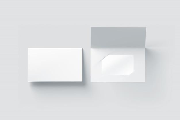 Макет пустой белой пластиковой карты внутри держателя бумажного буклета Premium Фотографии