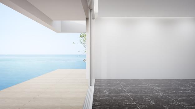 큰 거실의 빈 검은 대리석 바닥에 빈 흰 벽 프리미엄 사진