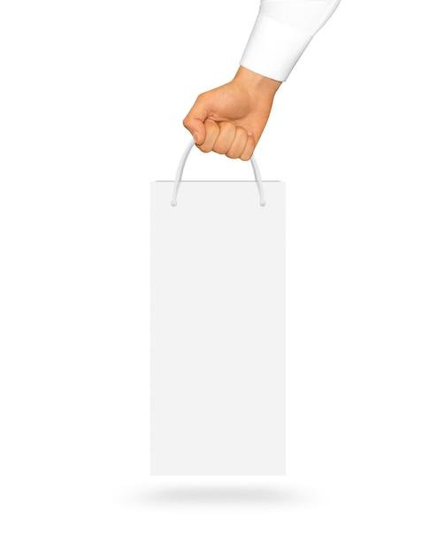 Blank white wine paper bag holding in hand Premium Photo