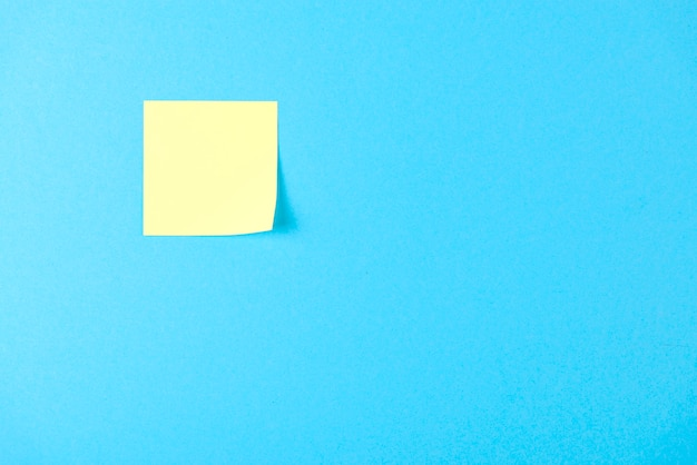 Blank yellow sticker on blue Premium Photo