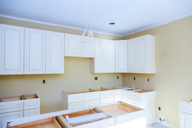Blind cabinet, island drawers and counter cabinets installed Premium Photo