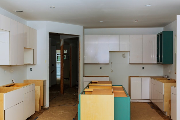 Blind corner cabinet, island drawers and counter cabinets installed Premium Photo