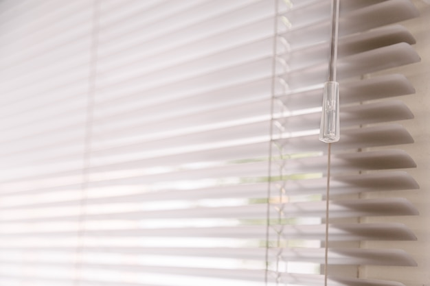 Blinds of sunlight come through the house. Premium Photo