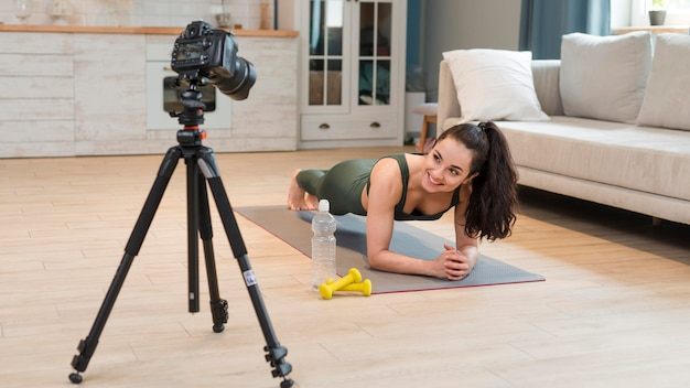 Blogger recording fitness class at home Premium Photo