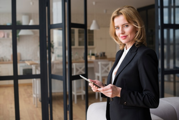 Blond business woman using tablet Free Photo