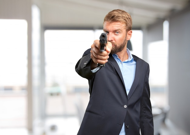 Blond businessman angry expression Free Photo