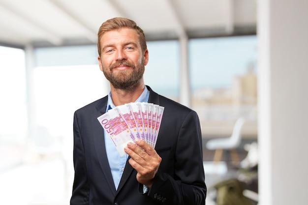 Blond businessman happy expression Free Photo