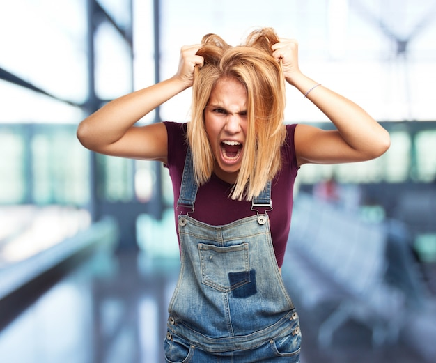 blond girl angry expression Free Photo