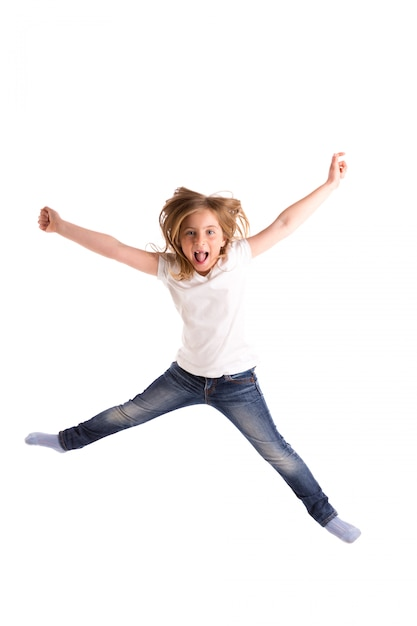 Blond kid girl indented jumping high wind on hair Premium Photo