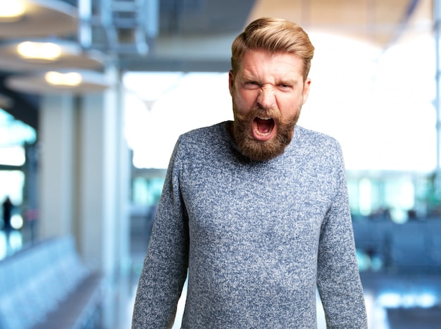 Blond man angry expression Free Photo