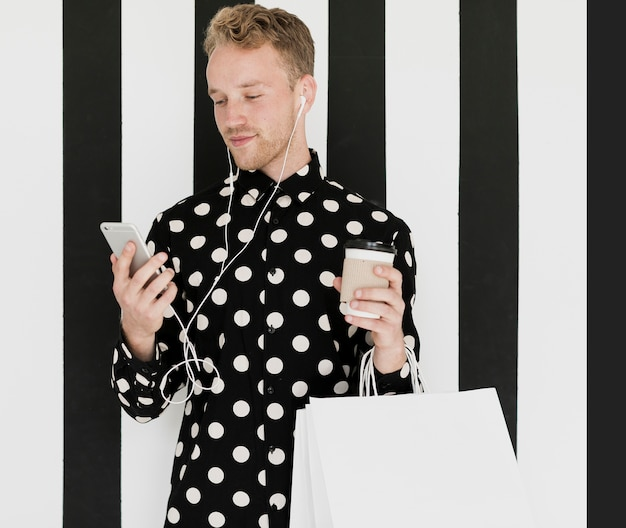 Blond man in shirt holding a coffee Free Photo