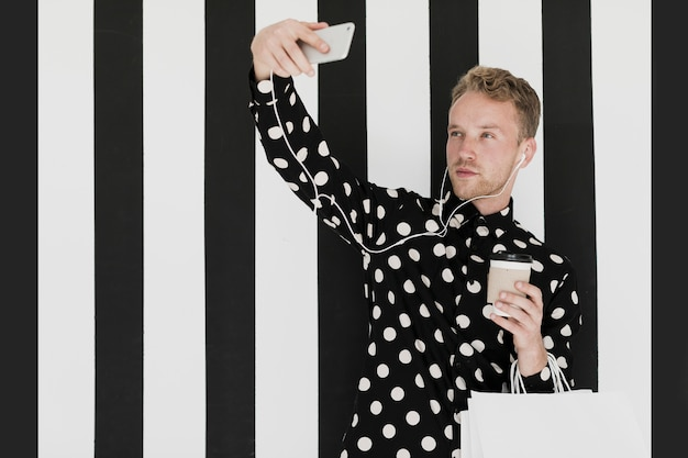 Blond man with shirt taking a selfie Free Photo