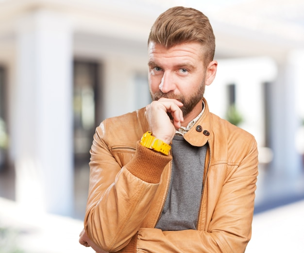Blond man worried expression Photo | Free Download