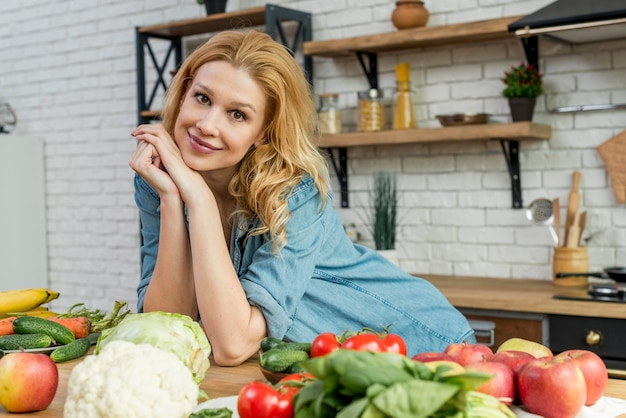 Blond woman in the kitchen Free Photo