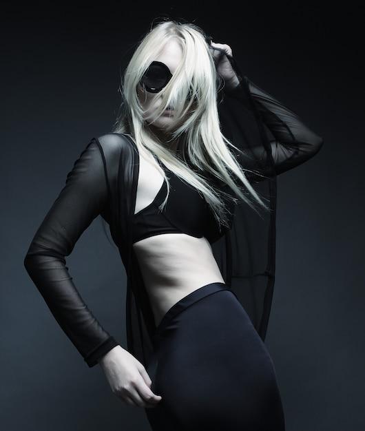 Blond woman posing in black lingerie Premium Photo