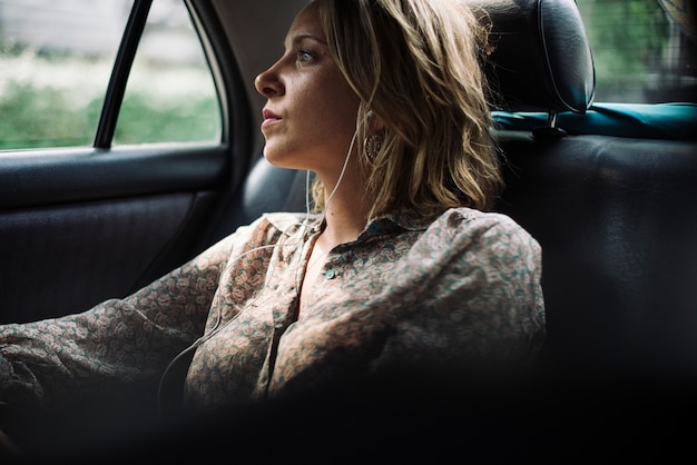 Premium Photo | Blond woman sitting in a taxi