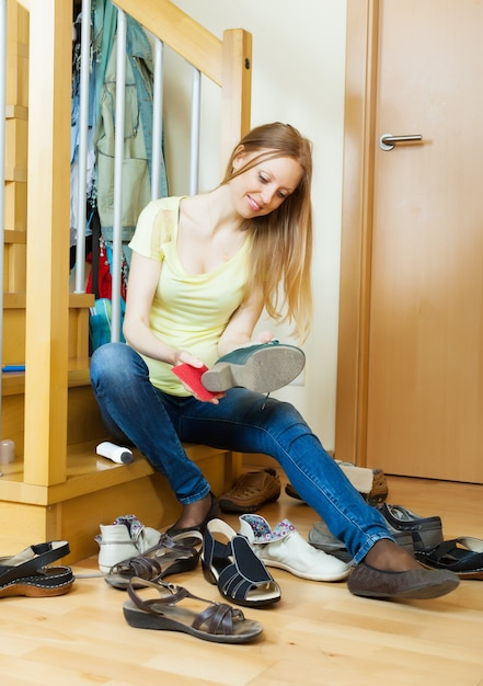 Blonde girl cleaning shoes Free Photo
