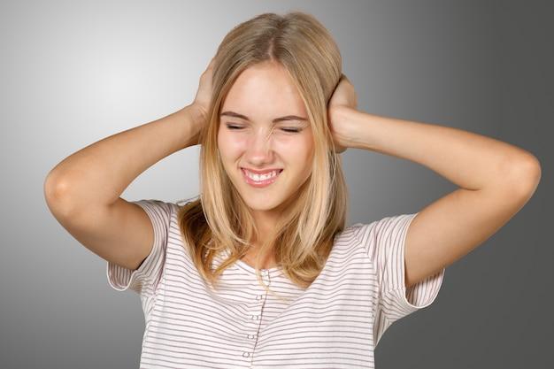 Blonde girl irritated and stressed Premium Photo