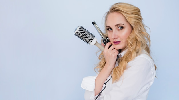 Blonde girl with hair brushes Free Photo