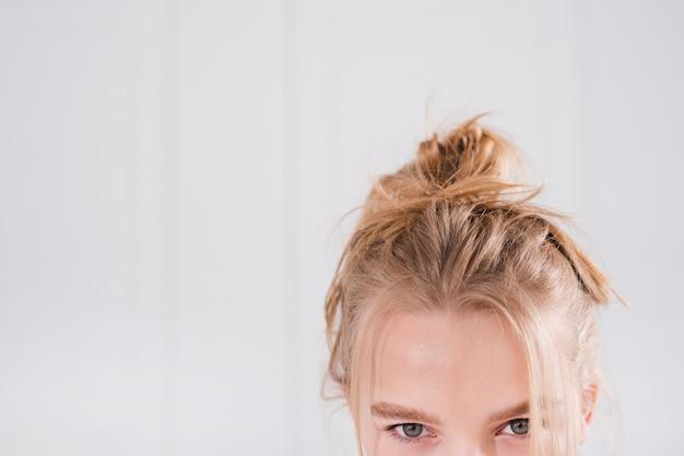 Blonde girl with messy bun Free Photo