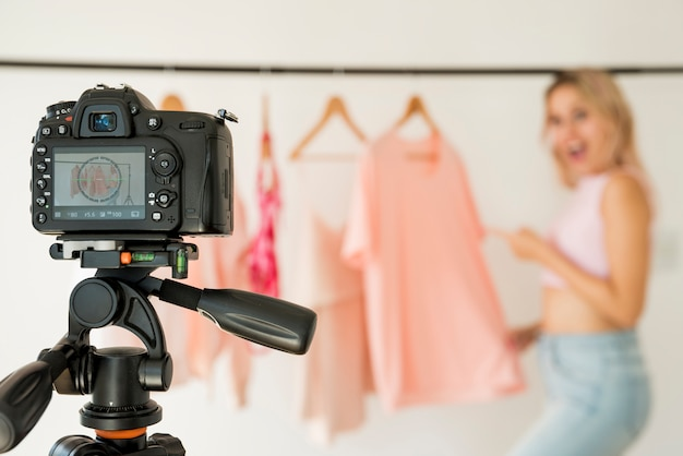 Blonde influencer recording fashion video Free Photo