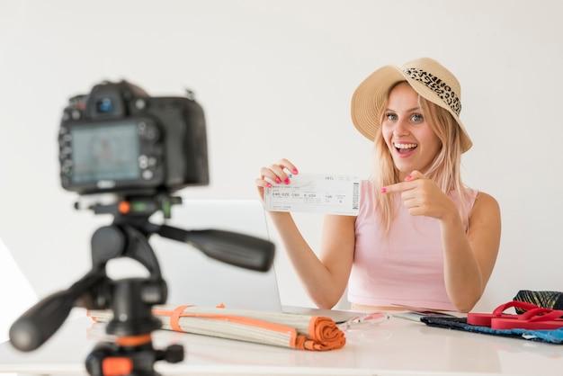 Blonde influencer recording holidays video Free Photo