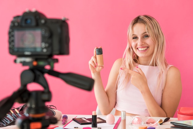 Blonde influencer recording make up video Free Photo
